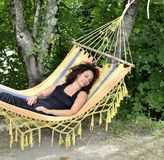 Mature woman relaxes on a hammock. Royalty Free Stock Photos
