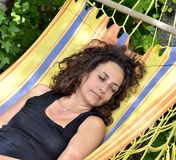 Mature woman relaxes on a hammock. Stock Photography