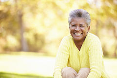 Mature Woman Relaxing In Autumn Landscape Royalty Free Stock Photo