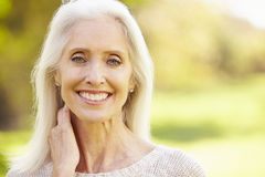 Mature Woman Relaxing In Autumn Landscape royalty free stock images