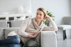Mature woman relaxing on couch Royalty Free Stock Image