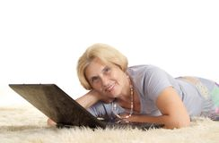 Mature woman relaxing Stock Photography