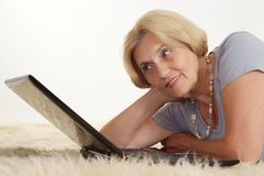 Mature woman relaxing Stock Image