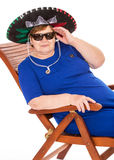 Mature woman relaxing on a lounger Stock Images