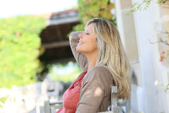 Mature woman relaxing outdoors Stock Images