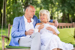 Mature woman relaxing with partner Stock Images
