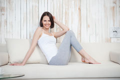 Mature woman relaxing on sofa stock photo
