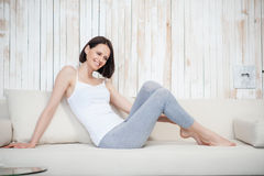 Mature woman relaxing on sofa Royalty Free Stock Photos