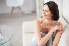 Mature woman relaxing on sofa royalty free stock image