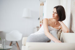 Mature woman relaxing on sofa Stock Photos