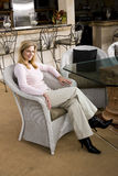 Mature woman relaxing on wicker chair Stock Image