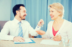 Mature woman and rent agent Royalty Free Stock Photography