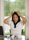 Mature woman ripping work papers in Anger Stock Photos