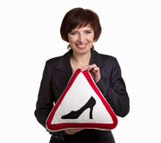 Mature woman with road sign Stock Photography