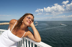 Mature Woman in Romantic White Dress at Ocean Stock Photo