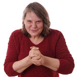 Mature woman rubbing hands Stock Images