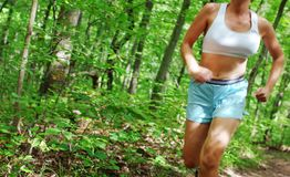 Mature Woman Runner. Mature woman running in forest stock images