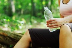 Mature Woman Runner Resting. In woods royalty free stock images