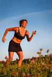 Mature woman running at morning Stock Images