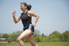 Mature woman running Stock Image