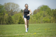 Mature woman running Stock Images