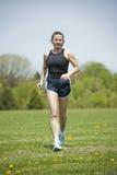 Mature woman running Royalty Free Stock Image