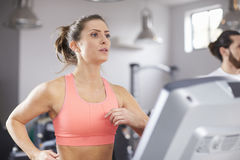 Mature Woman Running On Treadmill In Gym Stock Images