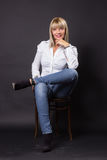 Mature woman 40s smiling sitting chair royalty free stock photos