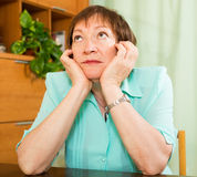 Mature woman with sad face Royalty Free Stock Images