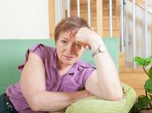 Mature woman with sad face Stock Image