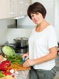 Mature woman salad Royalty Free Stock Photography