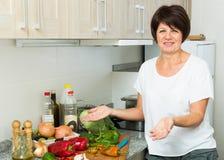 Mature woman salad Stock Photos