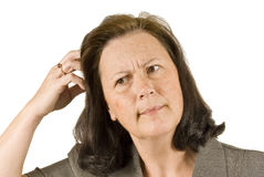 Mature Woman Scratching Head While Thinking Royalty Free Stock Photography