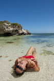 Mature Woman in seductive pose at tropical beach Royalty Free Stock Photo