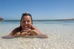 Mature Woman in seductive pose at tropical beach Stock Photos