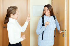 Mature woman sees off adult daughter at the door Royalty Free Stock Photo
