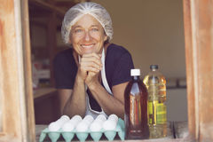 Mature woman selling eggs Royalty Free Stock Photo