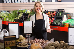 Mature woman selling vegetables Royalty Free Stock Images