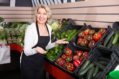 Mature woman selling vegetables Royalty Free Stock Photos