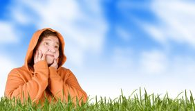 Mature woman (senior) on a meadow in grass Stock Photo
