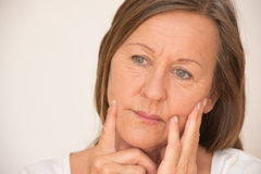 Mature woman serious thinking portrait Stock Photography