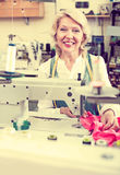 Mature woman sewing with professional machine Royalty Free Stock Photo