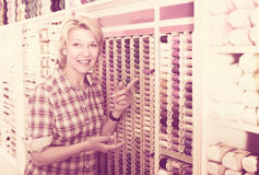Mature woman in sewing store Stock Images