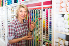 Mature woman in sewing store Stock Photo