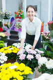 Mature woman in flowers shop Royalty Free Stock Photos