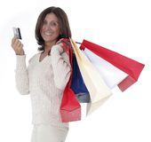 Mature woman shopping. Shopping mature woman with bags and credit card Stock Photography