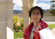Mature woman with shopping bags, outdoor Stock Photo