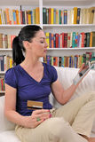 Mature woman shopping online. With digital pad Stock Photography