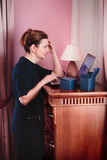 Mature woman shopping. Online with laptop from home Royalty Free Stock Photo