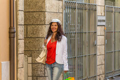 Mature woman shopping. Walking the streets of Italian city Royalty Free Stock Photo